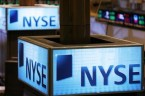 Signs can be seen above the floor of the New York Stock Exchange